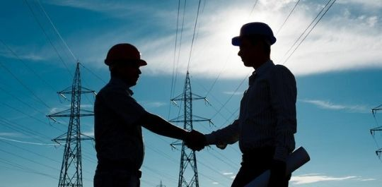 men shaking hands in energy industry