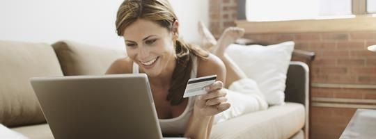 Omnichannel woman shopping online with credit card