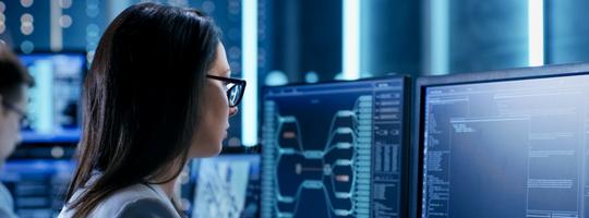 Woman IT Engineer Monitoring Data