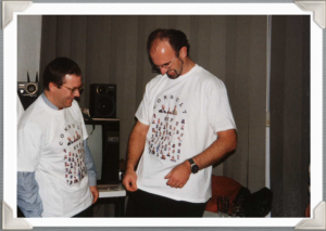 Herbert Vogel and Wolfgang Schmidt try on their new branded t-shirts.