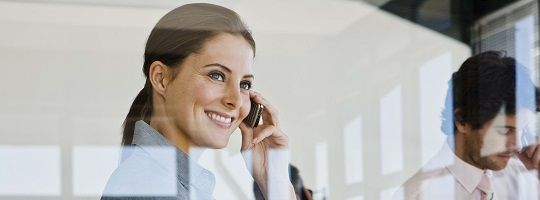 Image of smiling woman on cell phone