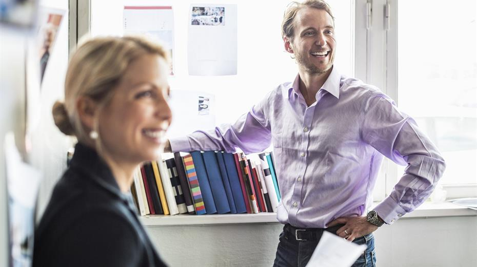 women and man in the office