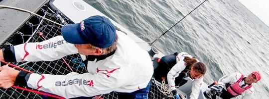 Regatta team working together successfully in an extreme situation
