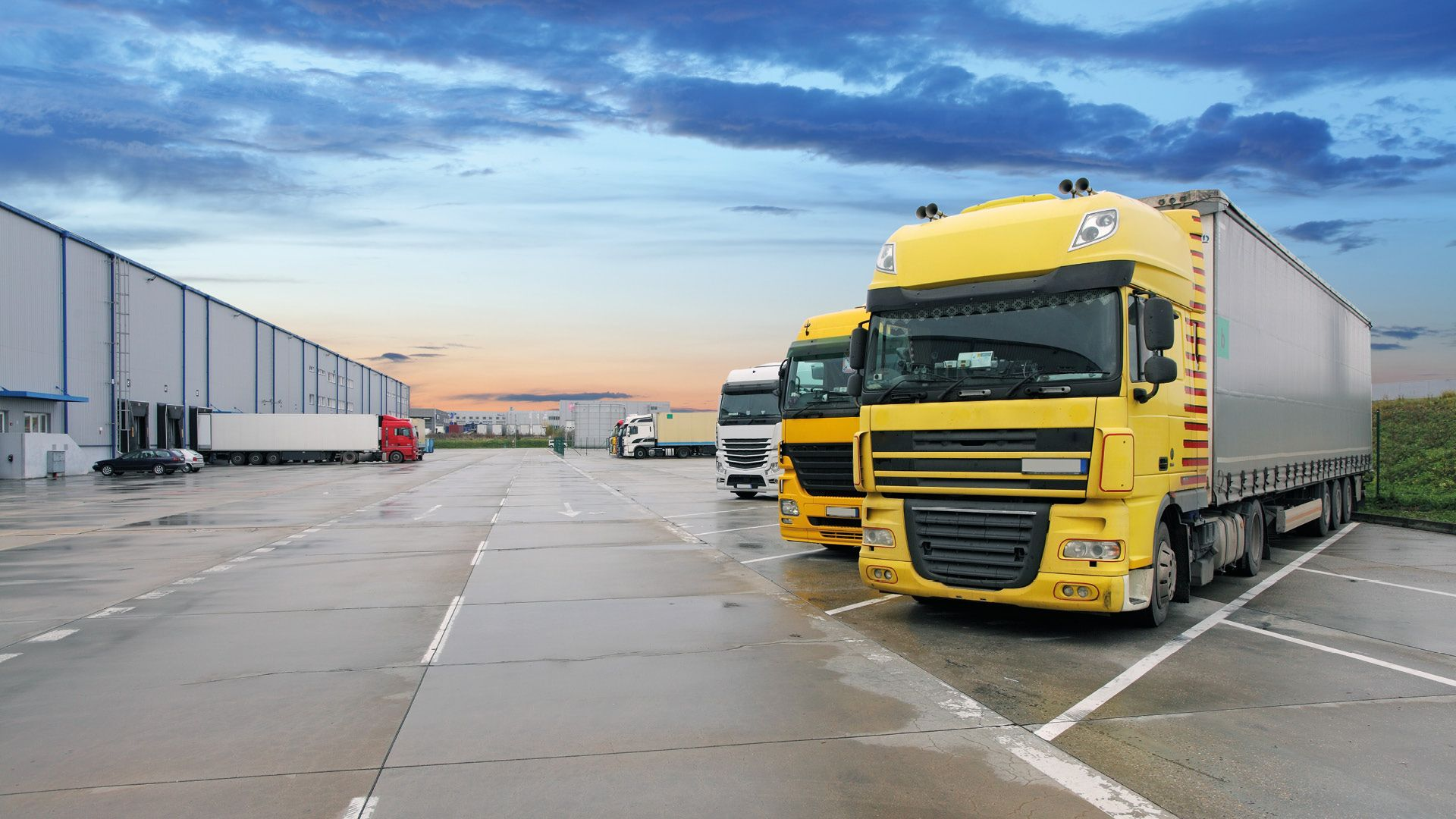 Sluyter Image of Trucks Parked at Terminal