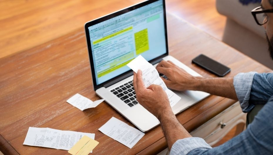 man working with receipts