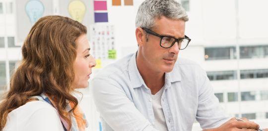 Man and woman collaborating on data analysis